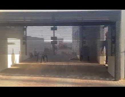 שער חניה פאנלים דגם צף